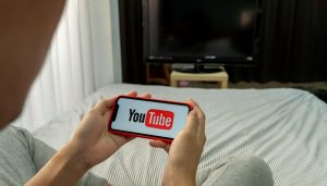 person YouTube mobile device